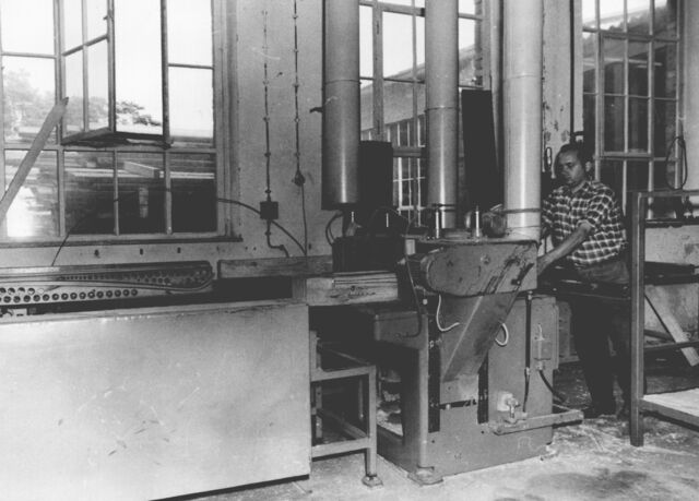 A man working on a machine in the factory