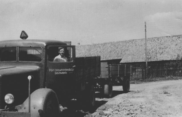 A man standing next to a truck